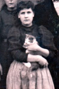 My grandmother, Mattie Kilborn holding a kitten, circa 1895