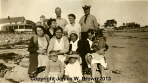 Group shot of summer servants of Mr. & Mrs. Aretas B. Carpenter, taken at Straw Point, Rye NH.  Nellie Ryan on left, 2nd row from top.