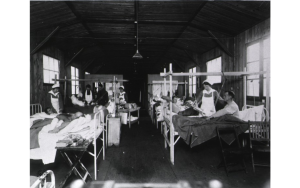 U. S. Army Base Hospital Number 52, Rimaucourt, France: General view of ward one, wounded being dressed