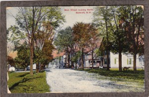 An old postcard showing the view of Benton NH's main street.