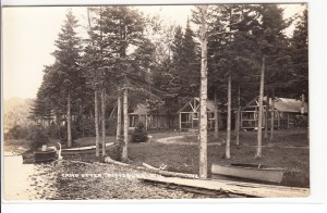 Old postcard showing close up of some cabins at Camp Otter, Pittsburg NH