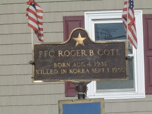 Photograph of Roger B. Cote recognition plaque, located in Manchester NH at the corners of Massabesic Street and Valley Street. Copyright of Martin Miccio for the City of Manchester, and used here with permission.