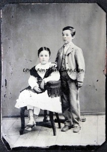 Tintype photograph of siblings Gardner and Georgianna Wyman.