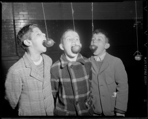 "Photograph: ""Boys eating apples off strings,"" Boston Public Library, Leslie Jones Collection [ca 1934-1956]."