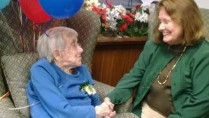 Photograph of Madeline Bennett with former pupil, Virginia Penrod at Madeline's 100th Birthday Part in Merrimack NH. Photograph courtesy of V. Penrod, used here with her permission.