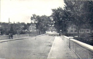 Old postcard photograph of the New Daniel Bridge (built in 1922) showing the Library and Central Street in the distance. This street was a part of the Daniel Webster Highway that extended from Nashua to the White Mountains. Daniel Webster was born 2-3/4 miles form the Highway at lower Franklin.
