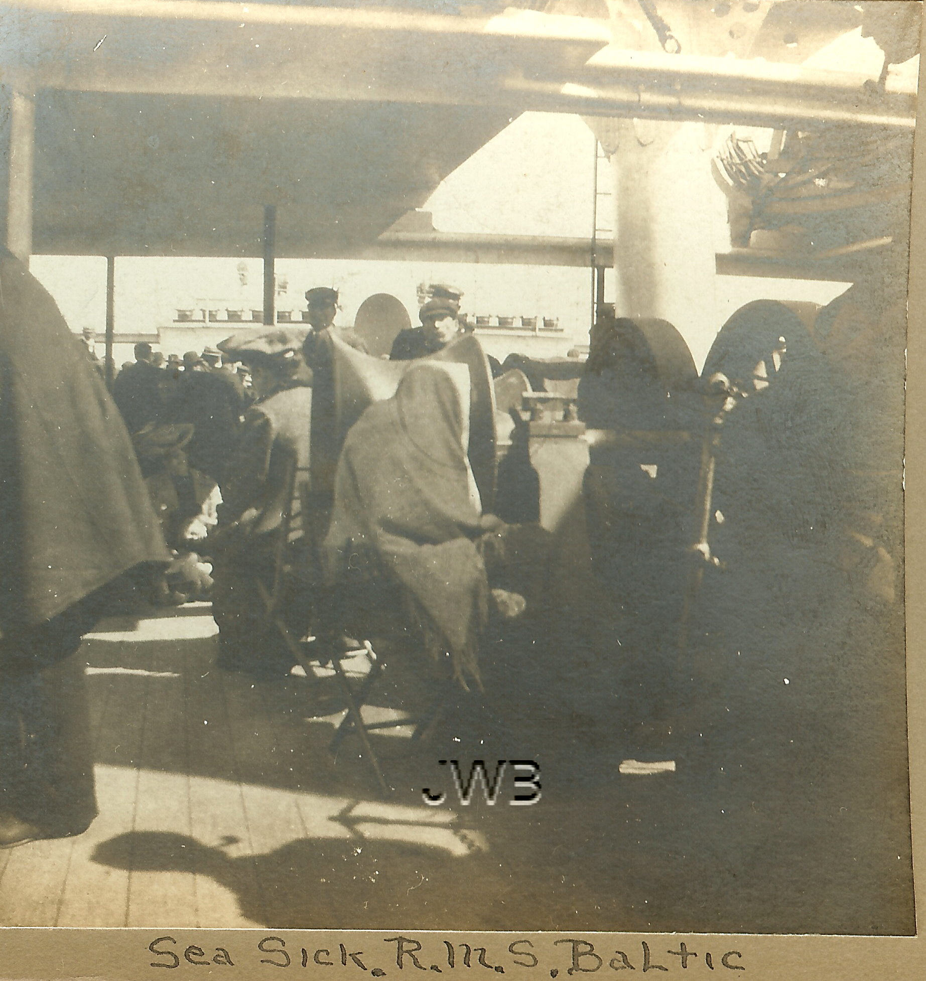 Seasick on deck of RMS Baltic, during 1904 voyage.  Rare stereograph view