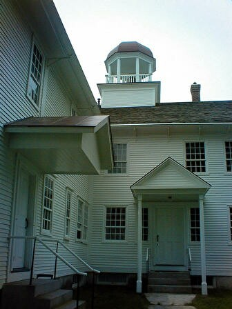 Example of a small covered porch often found at back doors of New England homes, this one at Shaker Village in Canterbury, New Hampshire.