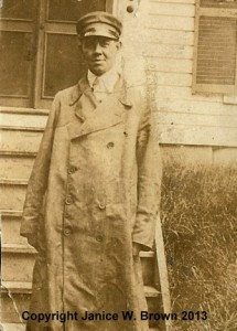 An early photograph of Charles A. Manning, in his driver's coat (probably pre-1918).