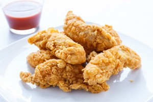PHOTOGRAPH © Dbvirago | Dreamstime.com - Chicken Strips With Hot Pepper Sauce Photo