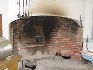 Photograph of a typical colonial fireplace used for cooking.