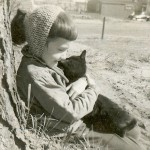 Janice Webster hiding out and doing her favorite thing, hugging a kitten.