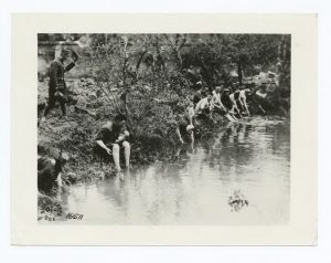 Men of 28th Infantry, 1st Div. bathing their feet after long hike into Soissons area. Near Montefontaine, France. July 16, 1918. The Miriam and Ira D. Wallach Division of Art. The New York Public Library Digital Collections.