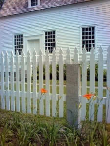 Bright flowers against a Canterbury NH fence