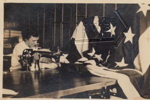 Woman at sewing machine working on American flag, Manchester NH.