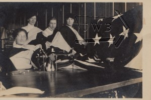 Women posing with flag, mill in Manchester NH.